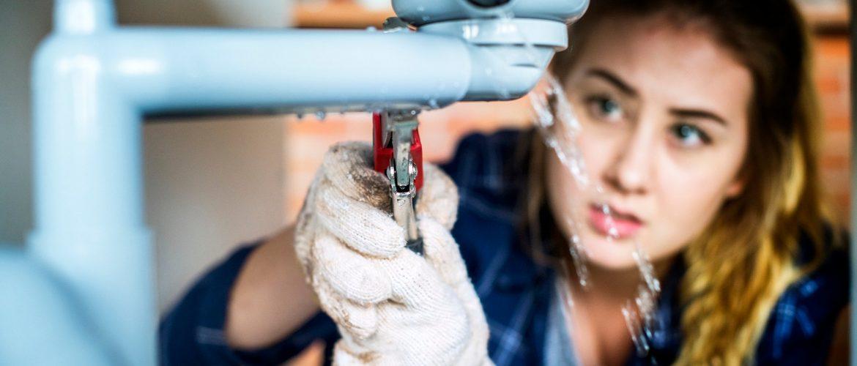 Woman fixing kitchen sink